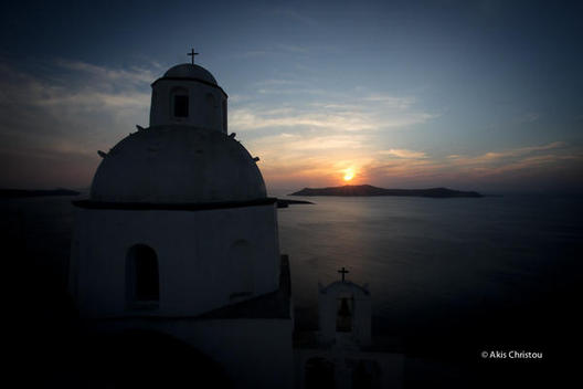 A church in Fira and the beautiful sunset